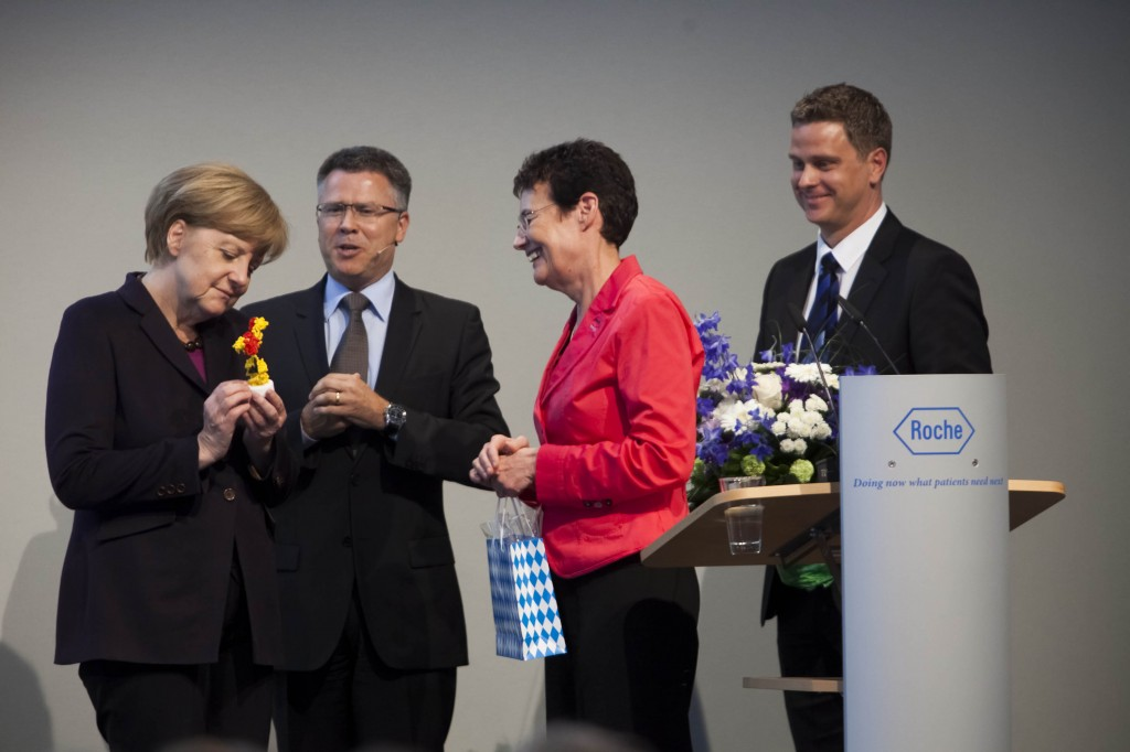 German Prime minister Angela Merkel receives a 3D printed antibody model.